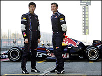 Mark Webber and David Coulthard pose with the new Red Bull-Renault RB3
