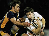 Wasps centre Dominick Waldouck is tackled by the Worcester defence
