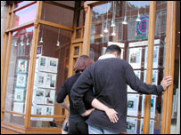 People looking into estate agent's window