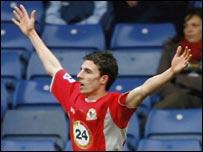 Matt Derbyshire celebrates heading his second goal for Blackburn