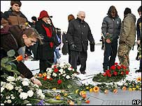 People lay flowers at commemoration ceremony at Buchenwald