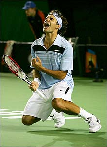 Federer celebrates winning the title