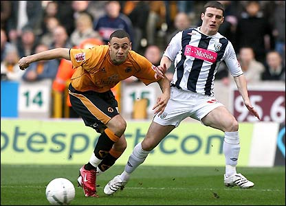 Wolves' Craig Davies and West Brom's Jason Koumas in action in the early stages