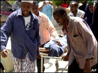 An injured man being taken to hospital in the Somali capital, Mogadishu