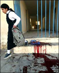 A girl leaves her school in Baghdad hit by deadly mortar attacks