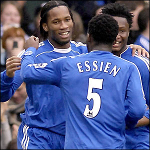 Drogba is congratulated by his team-mates after scoring