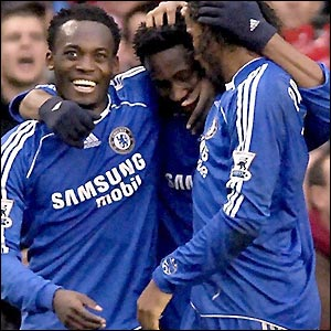 Michael Essien and Drogba celebrate with Obi