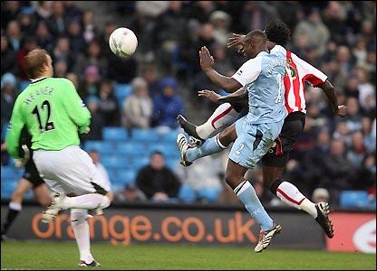 Jones nicks the ball over the advancing Nicky Weaver