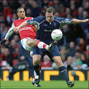 Gael Clichy and Kevin Davies contest possession