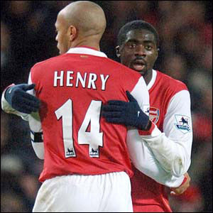 Thierry Henry celebrates with Toure after he scores the equaliser