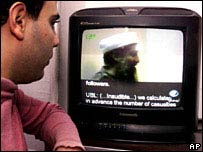 British Muslim watching TV featuring Osama Bin Laden