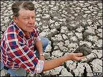 Australian farmer Marshall Rodda with some of his parched land