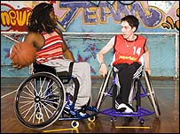 Photo of Ade Adepitan and wheelchair basketball player, Charlie