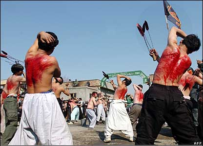 Afghan Shia Muslims with bloodied backs after flailing themselves