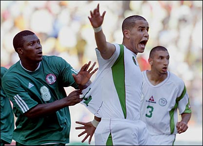 Madjid Bougherra (centre) in action for Algeria