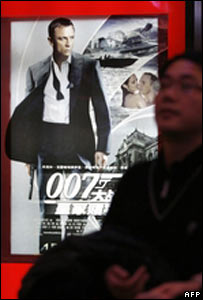 A man stands in front of a poster advertising 'Casino Royale' in China
