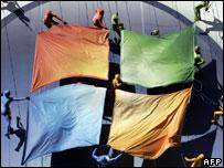 Windows flag held by people in costume