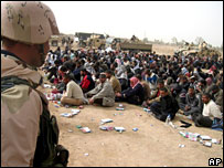 Arrested militants sit blindfolded after clashes at Zarqa, 20 kilometers (12 miles) northeast of Najaf, Iraq,