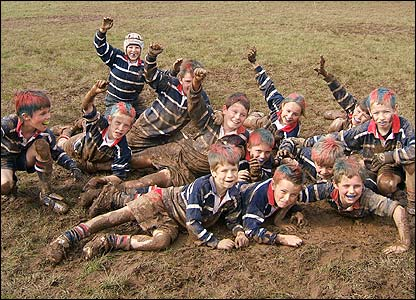 Brian Jennings shows Stourbridge U-10s in fine spirits in the mud after winning a local tournament in rather unpleasant conditions