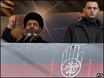 Sheikh Hassan Nasrallah (left) addresses crowd