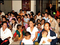 Hmong refugees gather before the planned repatriation in Thailand