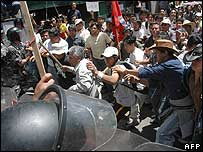 Protesters and police clash near the Congress building in Quito, Ecuador