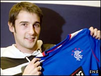 Kevin Thomson tries the Rangers shirt for size