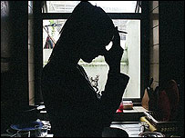 Silhouette of woman with head in hands