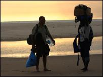 John James walking along the beach