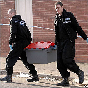 Officers carrying plastic box