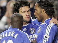 Didier Drogba (right) is congratulated by Michael Ballack (centre) and Lassana Diarra after his goal against Blackburn