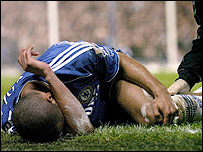 Ashley Cole lays injured in the game against Blackburn