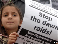 A child protesting against dawn raids