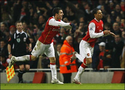 Jeremie Aliadiere and Cesc Fabregas celebrate in extra time