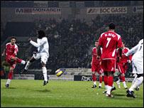 Talal El Karkouri drills home his free-kick