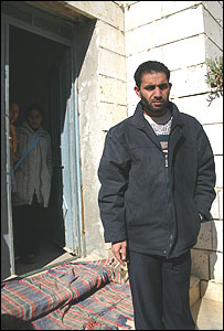 Bassam Aramin, Palestinian peace activist, outside his home