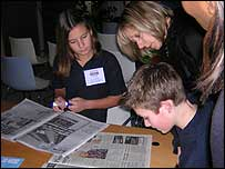 Students look through the newspapers