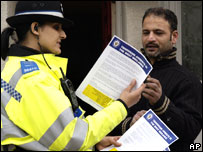 Pcso Ambi Dadar hands out a leaflet to a passer-by