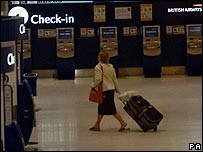 Women about to check-in at Heathrow