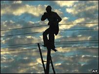 Man installs electricity pylons