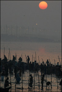Mela bathers at the confluence of the Ganges and Yamuna rivers on the holiest of bathing days