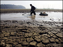 A fisherman at the drying Dongting Lake in Hunan, China