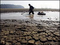 A fisherman at the drying Dongting Lake in Hunan, China
