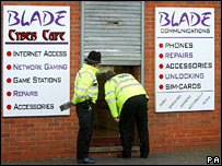 Police outside an internet cafe in Birmingham