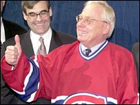 George Gillett dons a Montreal Canadiens shirt