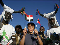 Chinese man with Sudanese in traditional costumes