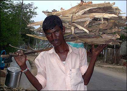 A man carrying firewood