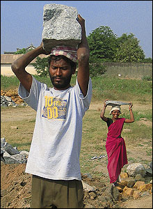 People carrying stones for the construction of the school