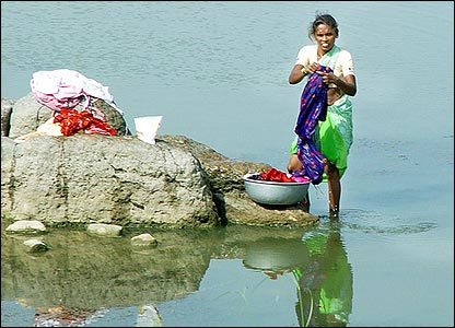 A woman doing the laundry in the river