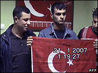 Photo dated 21 January 2007 shows suspect Ogun Samast with Turkish flag